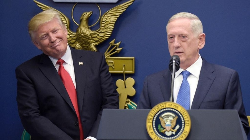 FILE - In this Jan. 27, 2017, file photo, U.S. Defense Secretary Jim Mattis, right, speaks as President Donald Trump, left, listens at the Pentagon in Washington. Mattis is making his debut with a visit to staunch U.S. allies South Korea and Japan, both of which host tens of thousands of American troops and, for good reason, see North Korea as their biggest national security threat. (AP Photo/Susan Walsh, File)
