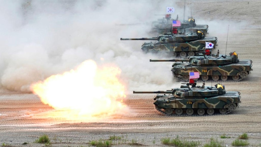 FILE- In this Wednesday, July 6, 2016, file photo, provided by the South Korean Defense Ministry, a South Korean marine K1 tank fires during a joint military exercise between South Korea and the United States in Pohang, South Korea. Pyongyang will cast a decidedly dark shadow over U.S. Defense Secretary Jim Mattis' first trip overseas. Mattis is to make his debut with a visit to staunch U.S. allies South Korea and Japan, both of which host tens of thousands of American troops and, for good reason, see North Korea as their biggest national security threat. (The South Korean Defense Ministry via AP, File)