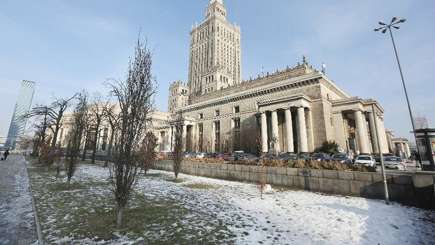 A valuable downtown plot of land is pictured in Warsaw, Poland, Monday, 30 Jan. 2017 at the center of a property restitution scandal. City officials, against the law, have given its ownership to people who have no link to its original owners, but who do huge business on acquiring and then reselling rights to real estate in Warsaw. Poland's top prosecutor's office says that a Warsaw lawyer and a former town hall official are among five people taken into custody over irregularities in real estate restitution. (AP Photo/Czarek Sokolowski)
