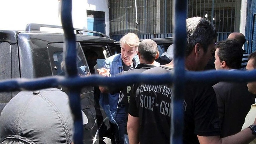 BRAZIL OUT - NAO PUBLICAR NO BRASIL - Businessman Eike Batista disembarks from a vehicle as he arrives to the Ary Franco prison, in Rio de Janeiro, Brazil, Monday, Jan 30, 2017. Police arrested Batista, a businessman who was once Brazil's richest man on corruption charges, as a string of plea bargains threatened to draw top politicians and executives into a massive graft probe. (Jose Lucena/Futura Press via AP)