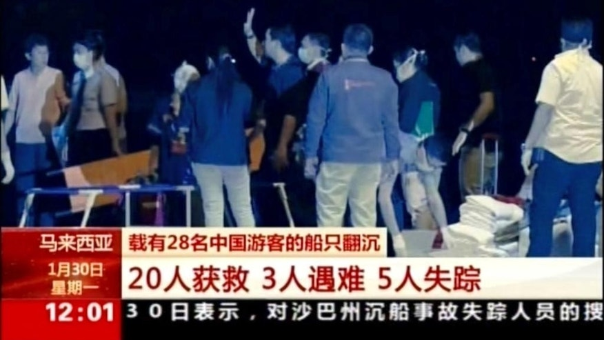 In this image made from video run by China's CCTV via AP Video, medical workers prepare to receive victims rescued from a boat sinking at the port in Kota Kinabalu, Sabah, Malaysia, Monday, Jan. 30, 2017. Malaysian authorities expanded the search Monday still missing two days after their boat sank off Borneo island. (CCTV via AP)