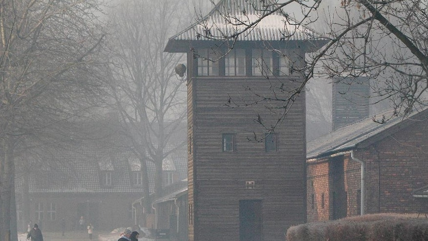 This photo taken on Friday, Jan. 27, 2017 in Oswiecim, Poland, shows a guard's tower of the former Nazi German death camp of Auschwitz that the Nazis operated in occupied Poland during World War II. Poland's historians have put online what they say is the most complete list of Nazi SS commanders and guards at Auschwitz, in hopes some of them can still be brought to justice. (AP Photo/Czarek Sokolowski)
