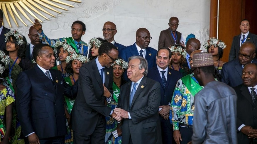 United Nations Secretary-General Antonio Guterres, centre right, shakes the hand of Rwandan President Paul Kagame during the 28th Ordinary Session of the Assembly of the African Union, in Addis Ababa, Ethiopia, Monday, Jan. 30, 2017. The U.N. Secretary General Antonio Guterres on Monday commended African countries for opening their borders to refugees and people fleeing violence.(AP Photo/Mulugeta Ayene )