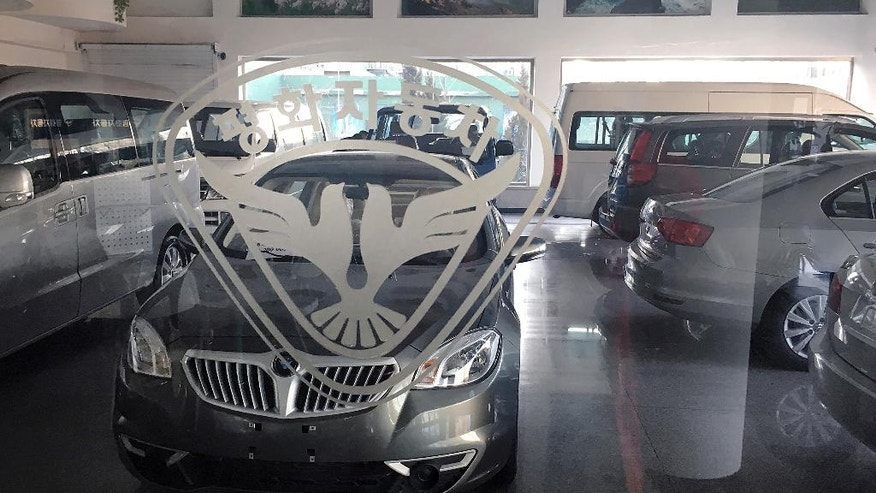 At a pyongyang car dealership only the logos are local for Fox motors used cars