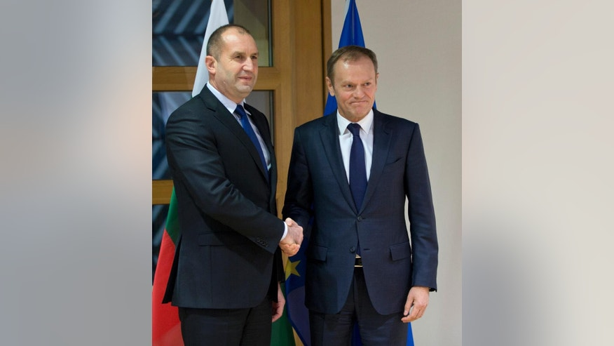 European Council President Donald Tusk, right, shakes hands with Bulgarian President Rumen Radev prior to a meeting at the EU Council building in Brussels on Monday, Jan. 30, 2017. (AP Photo/Virginia Mayo)