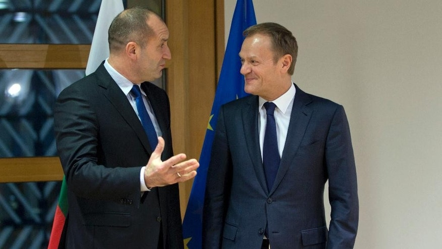 European Council President Donald Tusk, right, speaks with Bulgarian President Rumen Radev prior to a meeting at the EU Council building in Brussels on Monday, Jan. 30, 2017. (AP Photo/Virginia Mayo)