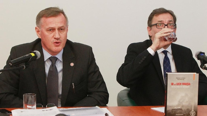 The chief prosecutor of the state National Remembrance Institute Andrzej Pozorski, left, and the head of the institute Jaroslaw Szarek, right, attend a news conference in Warsaw, Poland, Tuesday, Jan. 31, 2017, during which they presented an opinion by experts who say that handwriting analysis confirms beyond doubt that Solidarity founder Lech Walesa collaborated with the communist-era security police from 1970-76, wrote reports on other workers and signed receipts for money. Walesa, a former president and Nobel Peace Prize winner vehemently denies the allegations. (AP Photo/Czarek Sokolowski)