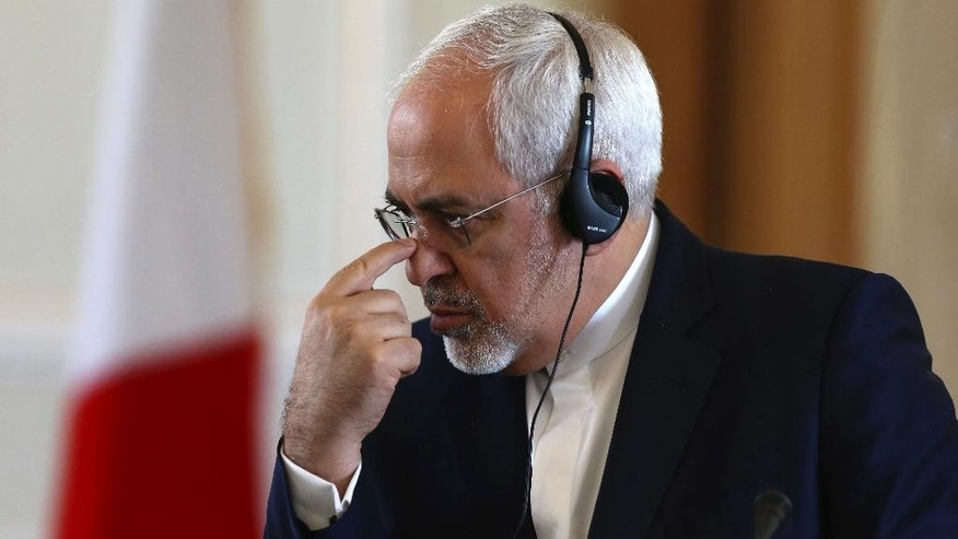 "Iranian Foreign Minister Mohammad Javad Zarif pauses while listening to a translation of his French counterpart Jean-Marc Ayrault during their joint press conference in Tehran, Iran, Tuesday, Jan. 31, 2017. At the press conference, Zarif refused to confirm that the country conducted a missile test, saying Iran's missile program is not part of a 2015 nuclear deal between his country and world powers. The White House said Monday it is studying the details of an Iranian ballistic missile test. A U.S. defense official said Monday that the missile test ended with a ""failed"" re-entry into earth's atmosphere. (AP Photo/Vahid Salemi)"