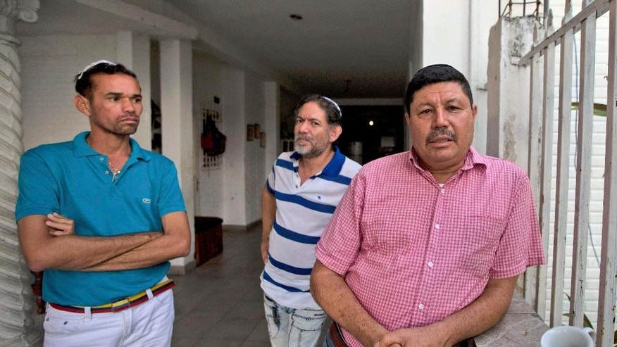 Venezuelan Jewish converts Hermidez Garcia, from right to left, Franklin Perez and Jackson Marrone, are photographed during an interview in their home in Maracay, Venezuela, Tuesday, Jan. 31, 2017. Israeli authorities said on Tuesday that nine Venezuelan Jewish converts that include Garcia, Perez and Marrone, will be allowed to move to Israel in light of the humanitarian crisis in Venezuela, reversing an earlier decision to keep them out. (AP Photo/Fernando Llano)