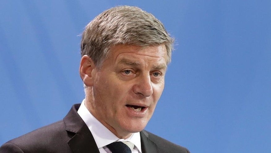 FILE - In this Monday, Jan. 16, 2017, file photo, New Zealand's Prime Minister Bill English addresses the media during a joint news conference with German Chancellor Angela Merkel as part of a meeting at the chancellery in Berlin, Germany. English announced Wednesday the country will hold its national election on Sept. 23 in what will become a test of his popularity following the surprise resignation of former leader John Key. (AP Photo/Michael Sohn, File)