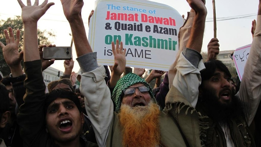 Supporters of Hafiz Saeed, head of the Pakistani religious charity, Jamaat-ud-Dawa, shout slogans to condemn his arrest, during a rally in Lahore, Pakistan, Tuesday, Jan. 31, 2017. Police say workers of the charity are holding countrywide protest rallies after authorities detained its militant leader Hafiz Saeed who has a $10 million US bounty. Saeed's Jamaat-ud-Dawa is a front for Lashkar-e-Taiba, the group behind the 2008 Mumbai attacks. (AP Photo/K.M. Chaudary)