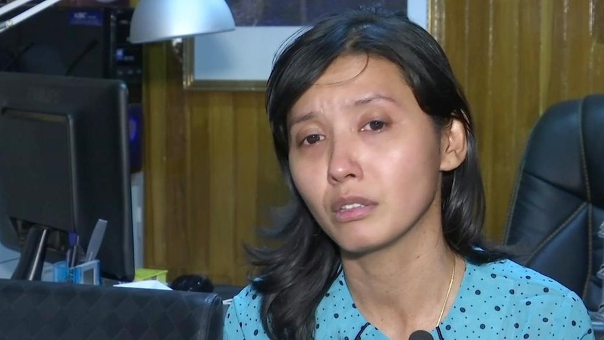 In this image taken from video, Yin Nwe Khine, daughter of assassinated Myanmar legal adviser Ko Ni, speaks during an interview with the Associated Press in Yangon, Tuesday, Jan. 31, 2017. The daughter of an assassinated Myanmar legal adviser says his family worried about his political activities and warned him to be careful, but he pursued his work for the sake of Myanmar's people, regardless of who they were. (AP Photo)