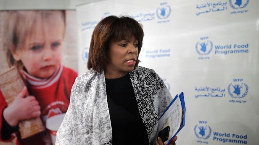 FILE - In this Aug. 19, 2015 file photo, the executive director of the U.N. World Food Program, Ertharin Cousin, speaks during a news conference in Cairo. The WFP said on Tuesday, Jan. 31, 2017, that Cousin won't seek a new five-year term at the U.N. food assistance agency. (AP Photo/Amr Nabil, File)