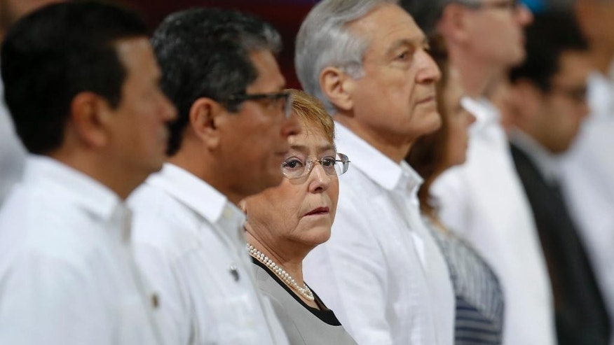 FILE - In this Oct. 29, 2016 file photo, Chile's President Michelle Bachelet, third from left, waits for the start of the opening ceremony of the 25th Ibero-American Summit in Cartagena, Colombia. Bachelet is denying reports she received financial support for her 2013 campaign from a construction conglomerate that is involved in Brazil's huge corruption scandal. The alleged link was made by the Brazilian magazine Veja, Wednesday, Feb. 1, 2017. (AP Photo/Fernando Vergara, File)