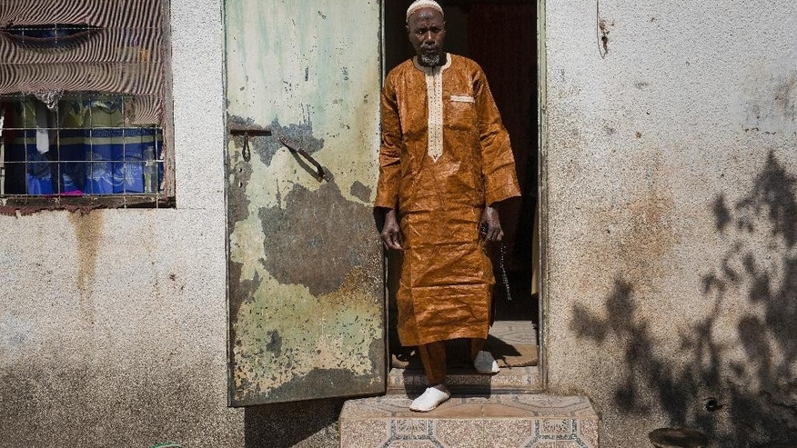 In this photo taken Friday Jan. 27, 2017, Imam Alhagie Ousman Sawaneh poses in his house in Kanifing, Gambia. Sawaneh was released Jan. 24, just days after former president Jammeh fled into exile in Equatorial Guinea. Sawaneh had been arrested in Oct. 2015. (AP Photo/Jerome Delay)