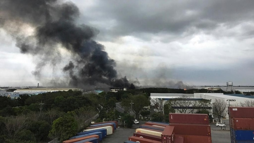 Smoke rises from a factory compound, Thursday, Feb. 2, 2017, in General Trias town in Cavite province, south of Manila, Philippines. The Cavite provincial governor says more than 100 workers, including three Japanese, have been injured and at least three are missing in a fire that hit a huge factory south of Manila and sent thousands of employees scampering to safety. (AP Photo/Joeal Calupitan)