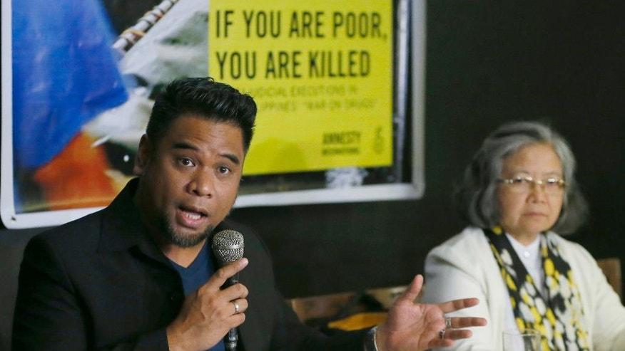 "Amnesty International campaigner Wilnor Papa, left, gestures during a video news conference with their London counterpart Rachel Chhoa-Howard and Sis. Maria Vida Cordero, right, in suburban Quezon city, northeast of Manila, Philippines. Wednesday, Feb. 1, 2017. A majority of the thousands of killings of poor suspects under Philippine President Rodrigo Duterte's anti-drug crackdown appear to be ""extrajudicial executions,"" Amnesty International said Wednesday, and may constitute crimes against humanity. (AP Photo/Bullit Marquez)"