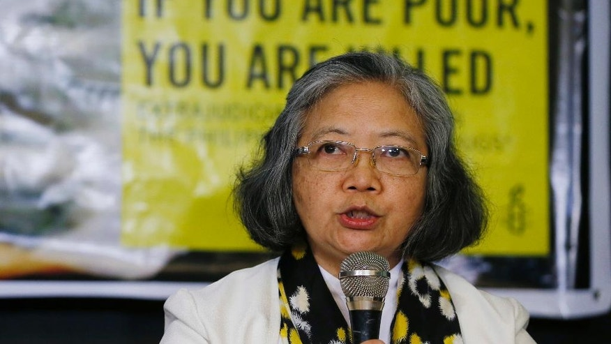 "Amnesty International's Board of Trustee Sis. Maria Vida Cordero addresses the media during a video news conference with her Amnesty International researcher Rachel Chhoa-Howard in London, Wednesday, Feb. 1, 2017 in suburban Quezon city, northeast of Manila, Philippines. A majority of the thousands of killings of poor suspects under Philippine President Rodrigo Duterte's anti-drug crackdown appear to be ""extrajudicial executions,"" Amnesty International said Wednesday, and may constitute crimes against humanity. (AP Photo/Bullit Marquez)"