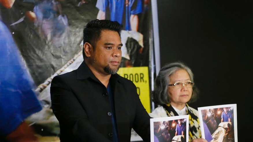 "Amnesty International campaigner Wilnor Papa, left, and Board of Trustee Sis. Maria Vida Cordero hold copies of the Amnesty's repport on extra-judicial killings in the country following a video news conference with their London counterpart Rachel Chhoa-Howard, in suburban Quezon city, northeast of Manila, Philippines Wednesday, Feb. 1, 2017. A majority of the thousands of killings of poor suspects under Philippine President Rodrigo Duterte's anti-drug crackdown appear to be ""extrajudicial executions,"" Amnesty International said Wednesday, and may constitute crimes against humanity. (AP Photo/Bullit Marquez)"