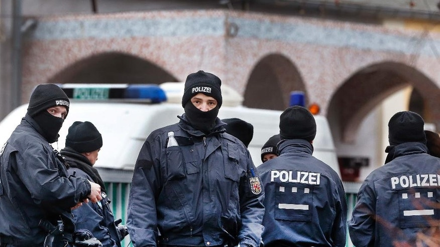 German police officers stand guard in front of a mosque during a terror raid in Frankfurt, Germany, Wednesday, Feb. 1, 2017.(AP Photo/Michael Probst)