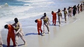 Islamic State militants lead what are said to be Ethiopian Christians along a beach in Wilayat Barqa, in this still image from an undated video made available on a social media website on April 19, 2015. The video purportedly made by Islamic State and posted on social media sites on Sunday appeared to show militants shooting and beheading about 30 Ethiopian Christians in Libya. Reuters was not able to verify the authenticity of the video but the killings resemble past violence carried out by Islamic State, an ultra-hardline group which has expanded its reach from strongholds in Iraq and Syria to conflict-ridden Libya. Libyan officials were not immediately available for comment. Ethiopia said it had not been able to verify whether the people shown in the video were its citizens. REUTERS/Social Media Website via Reuters TVATTENTION EDITORS - THIS PICTURE WAS PROVIDED BY A THIRD PARTY VIDEO. REUTERS IS UNABLE TO INDEPENDENTLY VERIFY THE AUTHENTICITY, CONTENT, LOCATION OR DATE OF THIS IMAGE. THIS PICTURE IS DISTRIBUTED EXACTLY AS RECEIVED BY REUTERS, AS A SERVICE TO CLIENTS. - RTR4XX9A