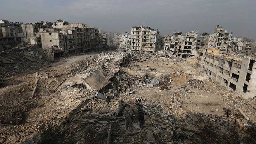 In this Friday, Jan. 20, 2017 photo, mounds of rubble remain from what used to be high rise apartment buildings in the once rebel-held Ansari neighborhood of eastern Aleppo, Syria. Aleppo, Syria's largest city, was widely brought to ruin by years of war, and now with Russia and Turkey leading peace efforts, international officials say it is time to start talking about rebuilding Aleppo and other cities. But there are few answers on how to do it, with the world reluctant to donate the billions needed and a political settlement in the war still uncertain and far off. (AP Photo/Hassan Ammar)