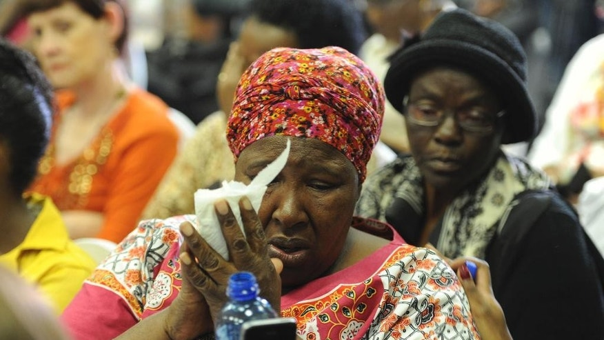 In this photo taken Wednesday, Feb 1, 2017 in Pretoria, South Africa's Bertha Molefe cries during an announcement of mentally ill patients who died after being transferred to non-governmental facilities allegedly operating with invalid licenses. Molefe's daughter, Sophia, was one of nearly 100 patients who died last year in South Africa's most developed province. (AP Photo)