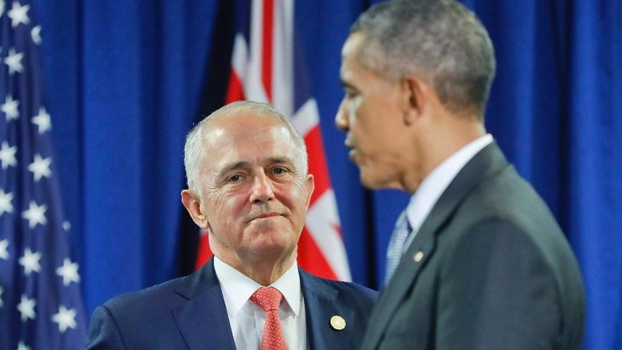 FILE - In this Nov. 20, 2016, file photo, Australia's Prime Minister Malcolm Turnbull talks with U.S. President Barack Obama following their meeting at the Asia-Pacific Economic Cooperation (APEC), in Lima, Peru. Amid the drama over a refugee resettlement deal between Australia and the United States during the Obama administration, the Trump White House has issued a series of conflicting statements on whether the agreement is still on, how many refugees it involves, and who, exactly, are the refugees. (AP Photo/Pablo Martinez Monsivais, File)