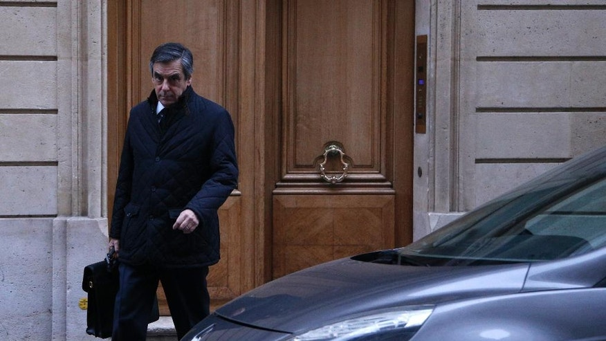 Conservative presidential candidate Francois Fillon leaves his home in Paris, Thursday, Feb. 2, 2017. Fillon has been under a preliminary probe since news reports said he paid his wife Penelope and two of the couple's children nearly one million dollars from public funds over the years for allegedly fake jobs as his parliamentary aides. (AP Photo/Thibault Camus)