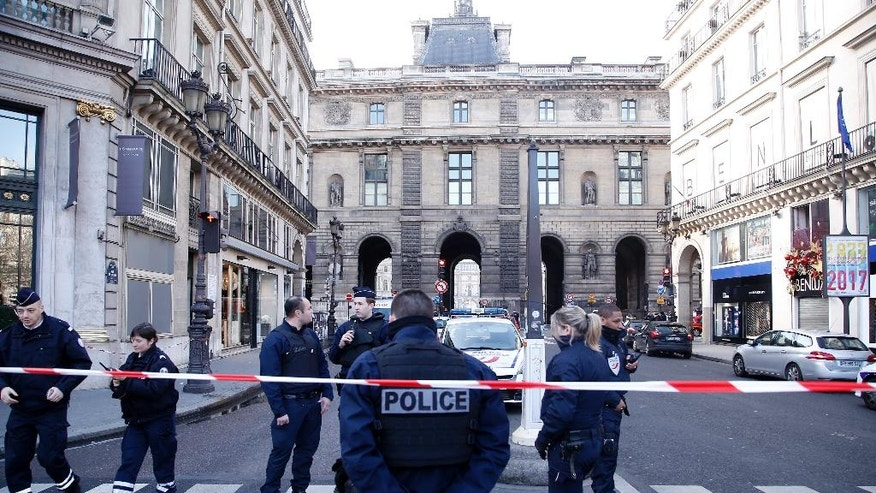 Police officers cordon off the area next to the Louvre museum in Paris,Friday, Feb. 3, 2017. Paris police say a soldier has opened fire outside the Louvre Museum after he was attacked by someone, and the area is being evacuated. (AP Photo/Thibault Camus)