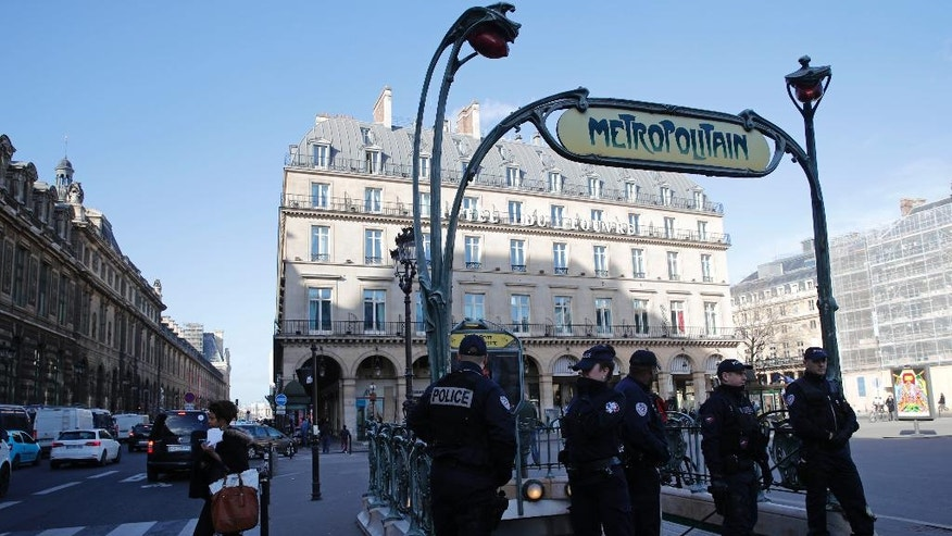 Police officers stand on patrol at a Metro station outside the Louvre museum near where a soldier opened fire after he was attacked in Paris, Friday, Feb. 3, 2017. Police say the soldier opened fire outside the Louvre Museum after he was attacked by someone, and the area is being evacuated. (AP Photo/Christophe Ena)