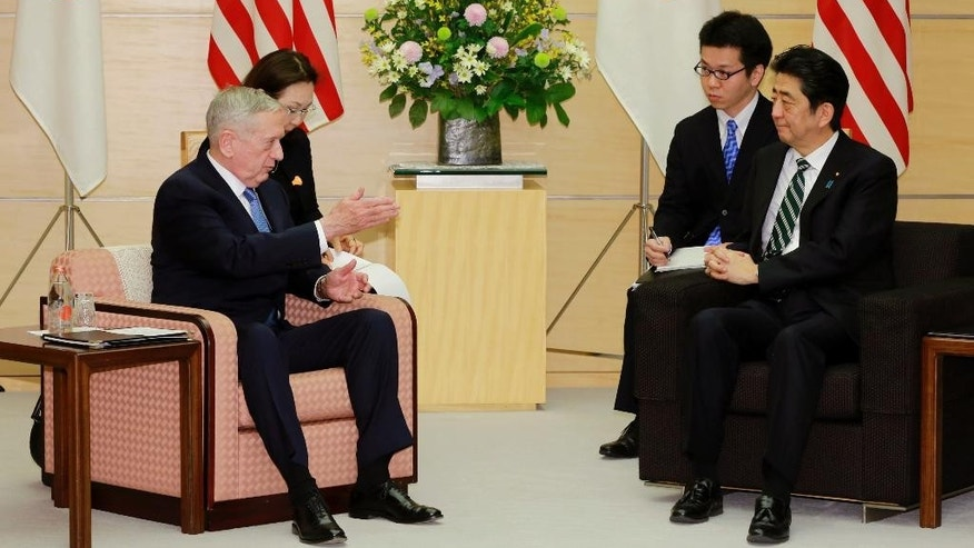 "U.S. Defense Secretary Jim Mattis, left, talks with Japanese Prime Minister Shinzo Abe, right,  at the prime minister's office in Tokyo, Friday, Feb. 3, 2017.  In an explicit warning to North Korea, U.S. Defense Secretary Mattis on Friday said any use of nuclear weapons by the North on the United States or its allies would be met with what he called an ""effective and overwhelming"" response. (AP Photo/Eugene Hoshiko, Pool)"