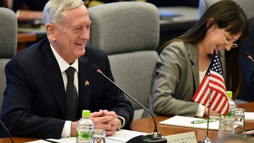 U.S. Defense Secretary Jim Mattis, left, smiles while speaking to  Japanese Defense Minister Tomomi Inada, unseen, at the start of their meeting at Defense Ministry in Tokyo, Saturday, Feb. 4, 2017. Mattis on Friday reassured two key U.S. treaty allies, South Korea and Japan, that President Donald Trump, who has raised doubts about the value of such partnerships, is fully committed to defending them.  (Franck Robichon/Pool Photo via AP)