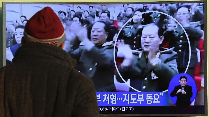 A man watches a public TV screen showing a file image of North Korea state security minister Kim Won Hong, who had been seen as close to leader Kim Jong Un, at the Seoul Railway Station in Seoul, South Korea, Friday, Feb. 3, 2017. North Korea fired Kim last month, presumably over corruption, abuse of power and torture committed by his agency, according to rival South Korea's government on Friday. (AP Photo/Ahn Young-joon)