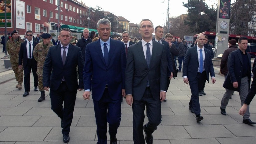 Kosovo president Hashim Thaci, center left, and NATO Secretary General Jens Stoltenberg walk in the main square of Kosovo's capital Pristina on Friday, Jan. 3, 2017. NATO Secretary General Jens Stoltenberg is in one day official visit to Kosovo. (AP Photo/Visar Kryeziu)