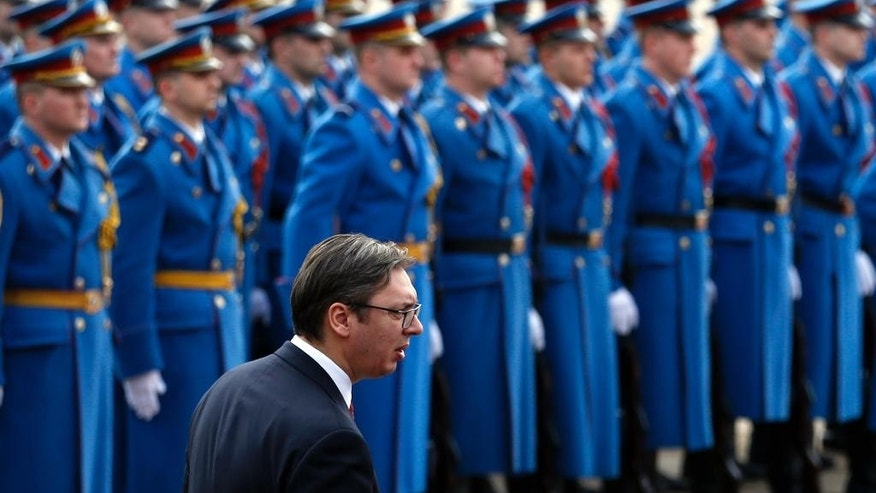Serbian Prime Minister Aleksandar Vucic reviews the honor guard during a welcoming ceremony for Montenegro's Prime Minister Dusko Markovic, at the Serbia Palace in Belgrade, Serbia, Friday, Feb. 3, 2017. Vucic has accused Kosovo for the collapse of EU-mediated talks as tensions escalated in the Balkans. (AP Photo/Darko Vojinovic)
