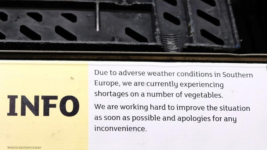 An information sign warning of vegetable shortages is displayed in a supermarket in London, Friday, Feb. 3, 2017. Europe is suffering a shortage of lettuce, broccoli and other vegetables, with shelves going bare in some supermarkets, due to bad weather. Stores in Britain were rationing Friday the number of lettuces shoppers can buy, with some removing iceberg, sweet gem and romaine varieties from their online offerings. (AP Photo/Kirsty Wigglesworth)
