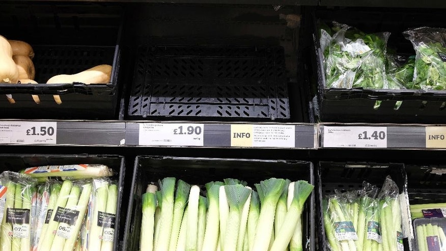 An empty shelf of courgettes, with a sign warning of vegetable shortages, is seen in a supermarket in London, Friday, Feb. 3, 2017. Europe is suffering a shortage of lettuce, broccoli and other vegetables, with shelves going bare in some supermarkets due to bad weather. Stores in Britain were rationing Friday the number of lettuces shoppers can buy, with some removing iceberg, sweet gem and romaine varieties from their online offerings. (AP Photo/Kirsty Wigglesworth)