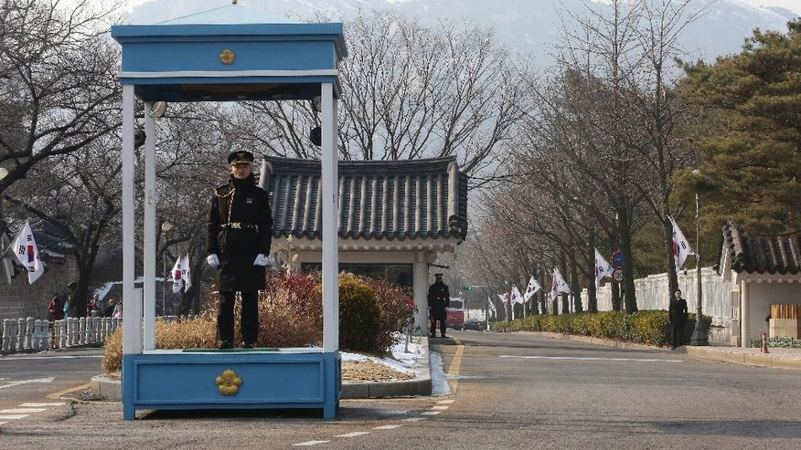 Police officers stand guard near the presidential Blue House in Seoul, South Korea, Friday, Feb. 3, 2017. South Korean officials Friday turned away prosecutors trying to search the president's mountainside compound, a confrontation that highlights the tensions of an investigation into a scandal that knocked President Park Geun-hye from power. (AP Photo/Ahn Young-joon)