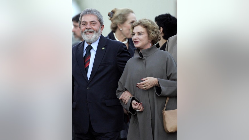 FILE - In this Sept. 14, 2007 file photo, Brazil's President Luiz Ignacio Lula da Silva, left, walks with his wife Marisa Leticia upon arrival to a military airbase in Torrejon de Ardoz, Spain. Doctors and the former president said Thursday, Feb. 2, 2017 Brazil's former first lady no longer has brain function and they are preparing to donate her organs. The 66-year-old former first lady had been hospitalized in Sao Paulo since Jan. 24 after suffering a stroke. (AP Photo/Paul White, File)