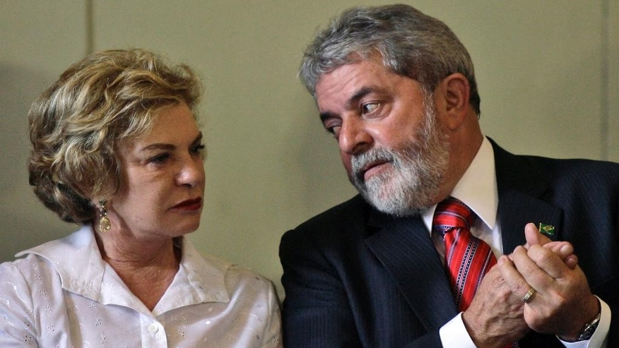 FILE - In this Jan. 25, 2008 file photo, Brazil's President Luiz Inacio Lula da Silva, right, talks with his wife Marisa Leticia at a ceremony in memory of the Holocaust at the Itamaraty Palace in Rio de Janeiro, Brazil. The former first lady, a constant and strong presence at the side of her husband during his rise to the presidency and his recent fall, has died on Feb. 3, 2017, hospital authorities said. (AP Photo/Ricardo Moraes)