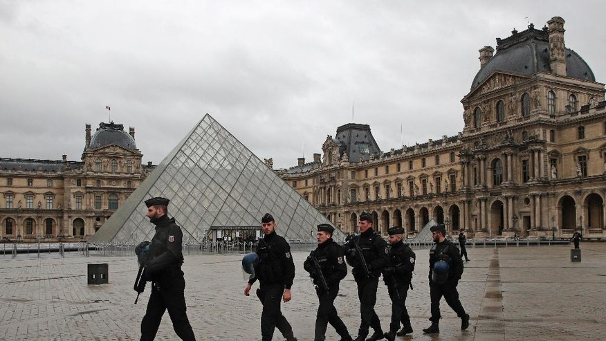 "Armed police officers patrol in the courtyard of the Louvre museum near where a soldier opened fire after he was attacked in Paris, Friday, Feb. 3, 2017. A knife-wielding man shouting ""Allahu akbar"" attacked French soldiers on patrol near the Louvre Museum Friday in what officials described as a suspected terror attack. The soldiers first tried to fight off the attacker and then opened fire, shooting him five times. (AP Photo/Christophe Ena)"