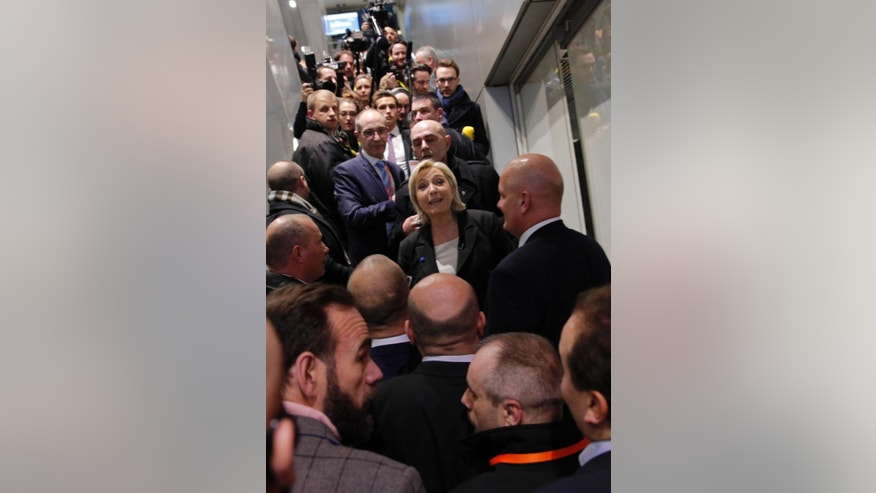 Far-right leader and candidate for next spring presidential elections Marine le Pen, center left, visits the Entrepreneur Fair, Wednesday, Feb. 1, 2017 in Paris, France. (AP Photo/Christophe Ena)