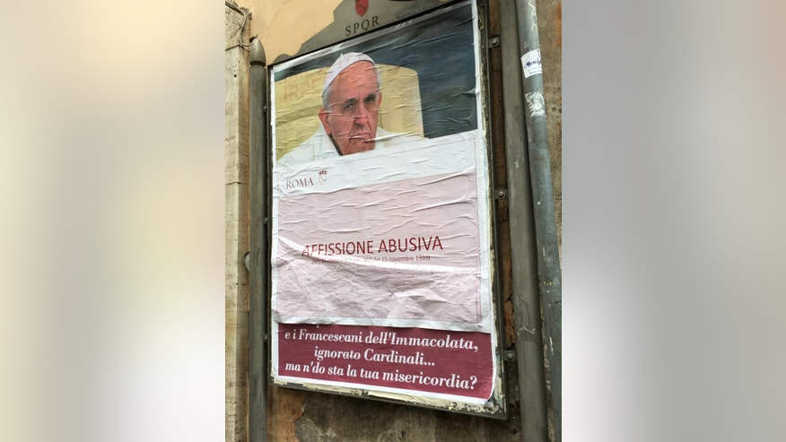 "A paper sheet with writing in Italian reading ""Illigal Posting"" covers an anti-Pope Francis poster in central Rome, Saturday, Feb. 4, 2017. On Saturday, posters appeared around Rome featuring a stern-looking Francis and questioning ""Where's your mercy?"" It referenced the ""decapitation"" of the Knights of Malta, Cardinal Raymond Burke's marginalization and other actions Francis has taken against conservative, tradition-minded groups. (AP Photo/Beatrice Larco)"