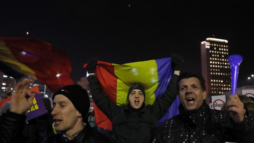 Protesters shout slogans during a protest in Bucharest, Romania, Friday, Feb. 3, 2017. Romania's political crisis is deepening over a government decree that may benefit rich and powerful people convicted of corruption. (AP Photo/Vadim Ghirda)