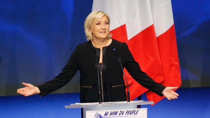 "Far-right leader presidential candidate Marine Le Pen gestures as she speaks during a conference in Lyon, France, Sunday, Feb. 5, 2017. Marine Le Pen, the far-right presidential candidate, unveiled her platform Saturday at the start of a weekend conference, envisioning a thriving nation ""made in France. (AP Photo/Michel Euler)"