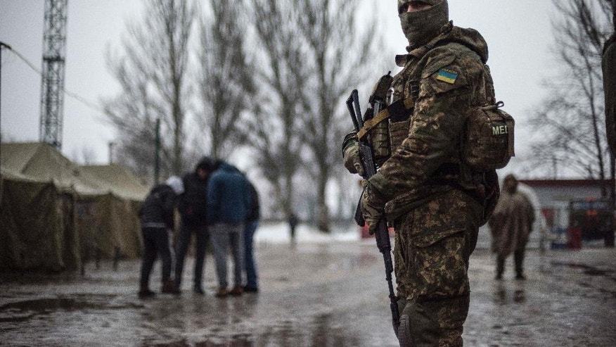 A Ukrainian serviceman patrols at the humanitarian aid center in Avdiivka, Ukraine, Saturday, Feb. 4, 2017. Fighting in eastern Ukraine sharply escalated this week. Ukraine's military said several soldiers were killed over the past day in shelling in eastern Ukraine, where fighting has escalated over the past week. (AP Photo/Evgeniy Maloletka)
