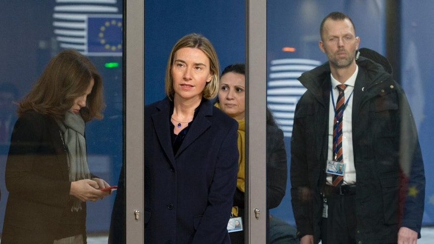 European Union foreign policy chief Federica Mogherini, center, arrives for a meeting of EU foreign ministers at the EU Council building on Monday, Feb. 6, 2017. (AP Photo/Virginia Mayo)
