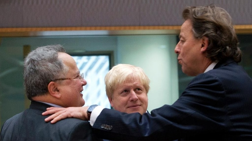 British Foreign Minister Boris Johnson, center, speaks with Greek Foreign Minister Nikos Kotzias, left, and Dutch Foreign Minister Bert Koenders, right, during a meeting of EU foreign ministers at the EU Council building on Monday, Feb. 6, 2017. (AP Photo/Virginia Mayo)