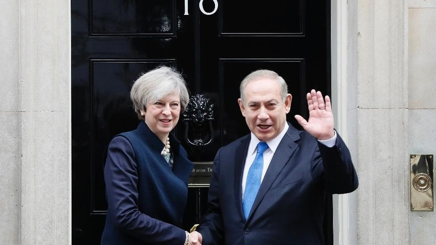 Britain's Prime Minister Theresa May greets Prime Minister Benjamin Netanyahu of Israel at Downing Street in London, Monday, Feb. 6, 2017. (AP Photo/Kirsty Wigglesworth)